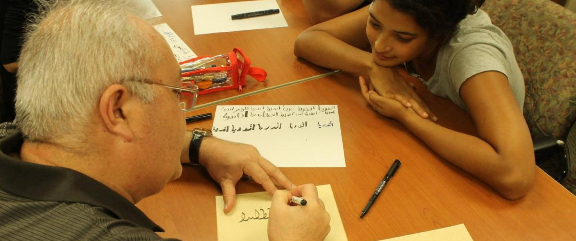 Students writing in Arabic