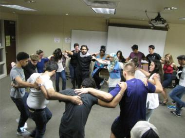 University of Arizona students learning traditional Dabkeh dance